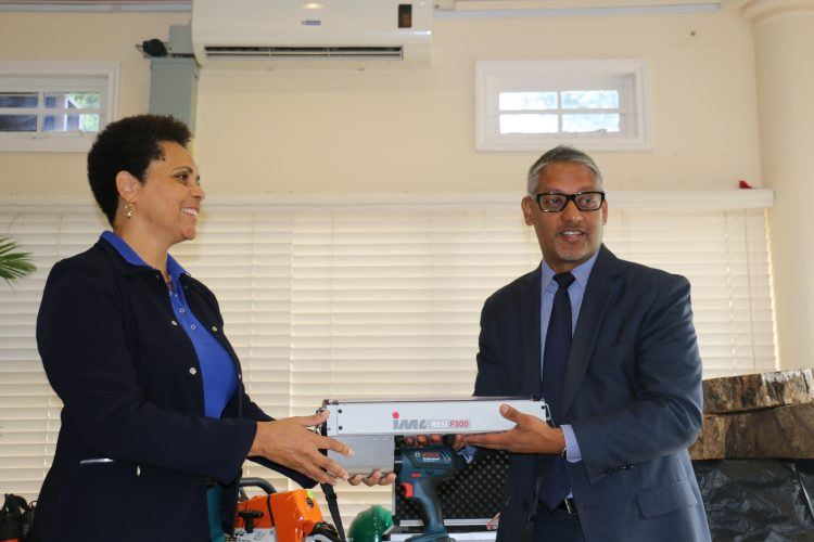 Photo 3- IICA Representative to Trinidad and Tobago, Ms. Diana Francis and Tobago make the presentation of a Resistograph to the Minister of Agriculture, Lands and Fisheries